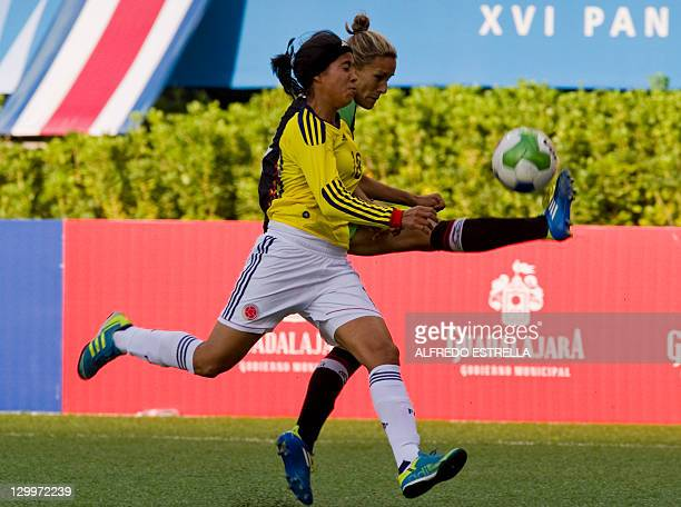 Colombian player Katerin Castro vies for the ball with Mexican Jennifer Ruiz during a women's first round football match of the Guadalajara 2011 XVI...