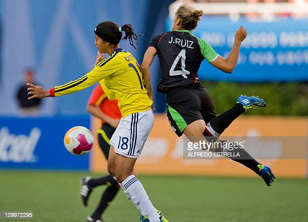 Colombian player Katerin Castro vies with Mexican Jennifer Ruiz during a women's first round football match of the Guadalajara 2011 XVI PanAmerican...