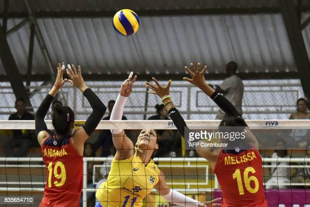 Colombian players Amanda Coneo and Melissa Rangel try to block the smash by Brazilian Tandara Caixeta during the Women's South American Volleyball...