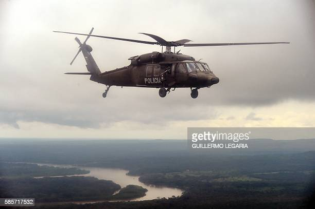 A Colombian police Blackhawk helicopter un flight after taking off from the airbase in San Jose del Guaviare to participate in an operation to...