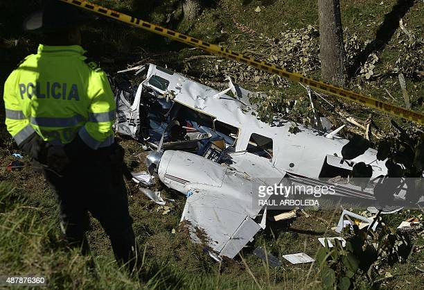 Colombian Police custody the wreckage of a Piper PA60 Aerostar twinengine aircraft that crashed on the eve on September 12 2015 near San Pedro de los...