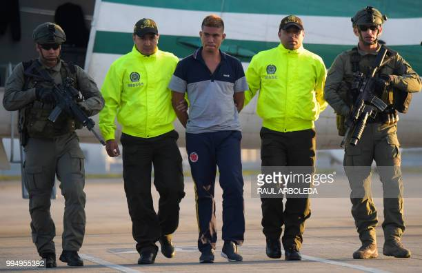 Colombian police escort Jesus Vargas aka Reinel who was allegedly in charge of guarding the members of the news team from Ecuadorean newspaper El...