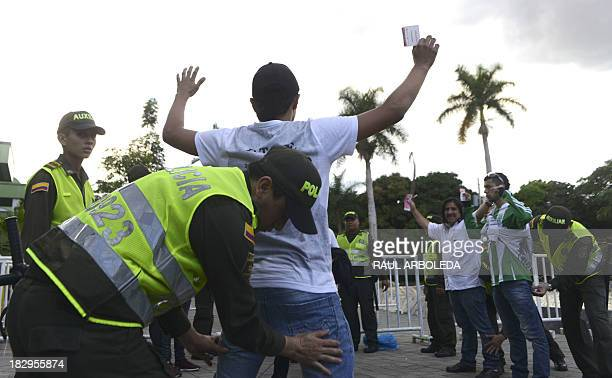 Colombian police frisk supporters before the start of the Atletico Nacional vs Independiente Medellin football match at the Atanasio Girardot stadium...