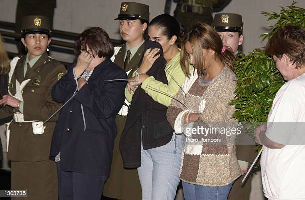 Colombian police line up a group of alleged drug traffickers at police headquarters November 1, 2000 in Bogota. 49 suspects were arrested by a joint...