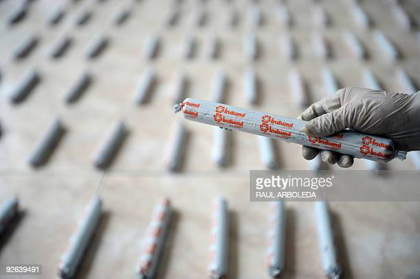 A Colombian police officer holds a stick of dynamite on November 3 2009 in Medellin Antioquia department Colombia Members of the Colombian Police...