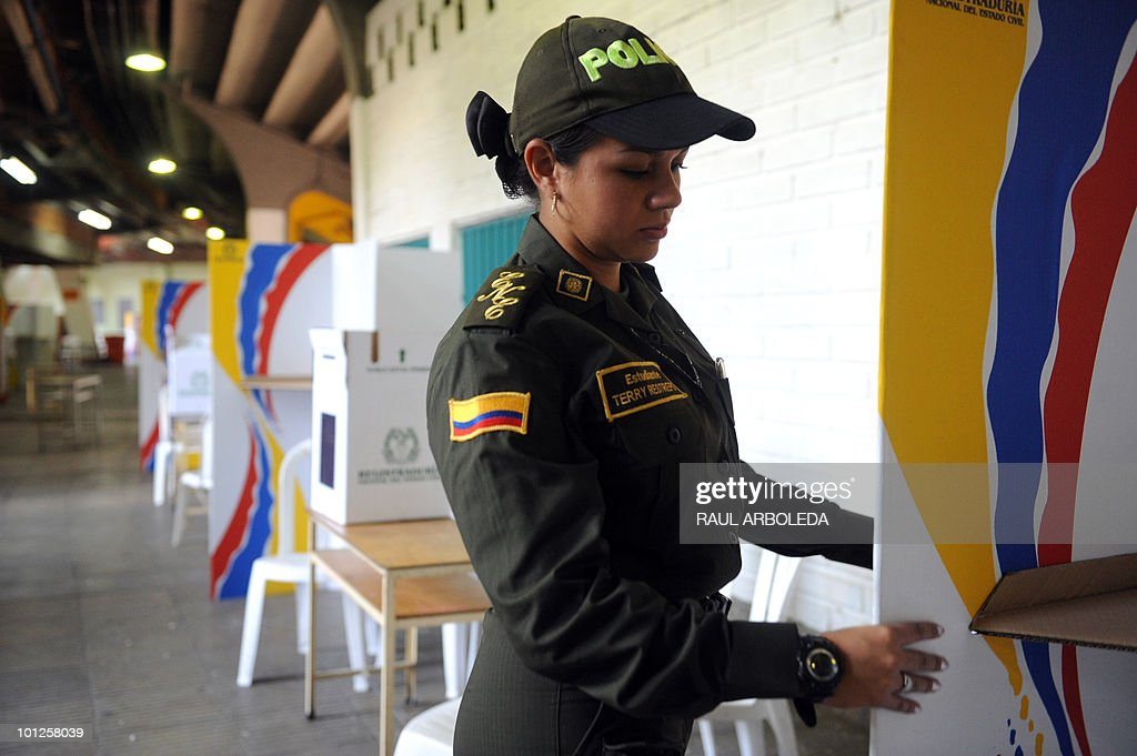 A Colombian police officer inspects electoral stuff at a polling center in Medelllin, Antioquia department, Colombia on May 29, 2010. Colombia will hold presidential elections next May 30, and according to polls, a run-off election between Antanas Mockus for the Green Party and Juan Manuel Santos for the ruling National Unity Party, will take place on June 20. AFP PHOTO/ Raul ARBOLEDA