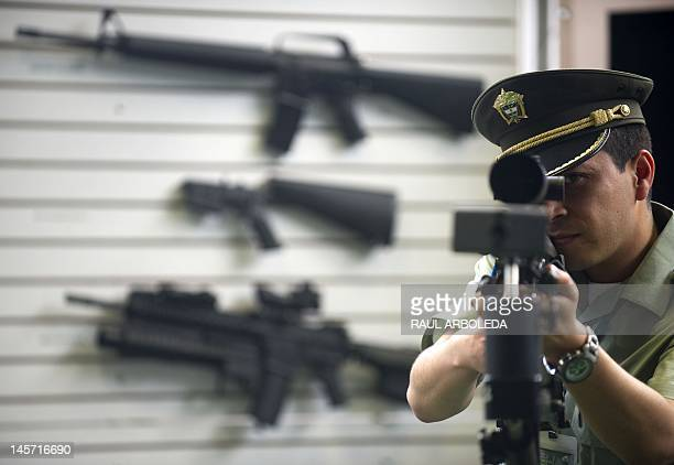 A Colombian police officer shows a Barrett M95 50 caliber sniper rifle being displayed during the 10th Regional Conference of the International...