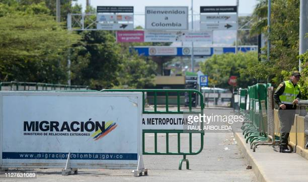 A Colombian police officer stand on the Simon Bolivar International Bridge on February 26 2019 in Cucuta Colombia on the border with Venezuela which...