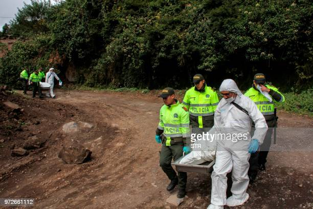 Colombian police officers carry the bodies of two people killed by an earthquake on June 12 in Briceno Narino department Colombia A shallow...