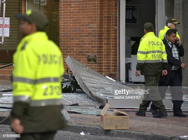 Colombian police officers check the site of an explosion in the financial heart of Bogota on July 2 2015 Two explosions rocked the Colombian capital...