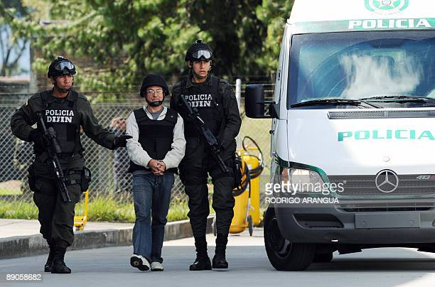 Colombian police officers escort Revolutionary Armed Forces of Colombia member Gerardo Aguilar aka Cesar before being extradited to the US at Catam...