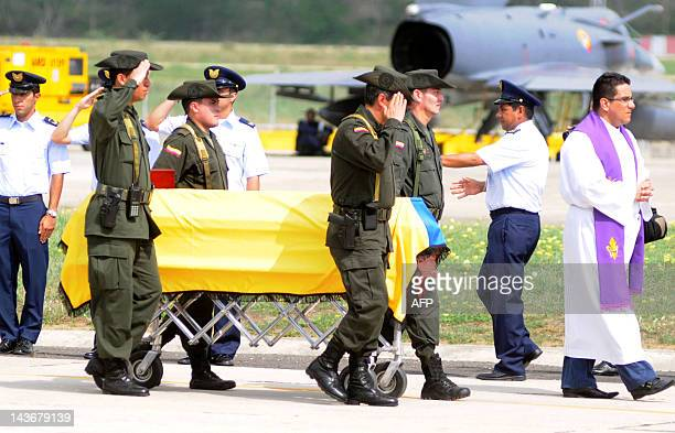 Colombian police officers escort the coffin of a colleague killed in a helicopter crash at a military airport in Barranquilla Colombia on May 2 prior...
