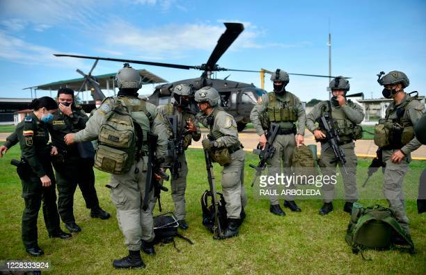 Colombian police officers get ready before taking part in the sixth phase of the Artemisa Campaign to combat deforestation in the Amazonian...