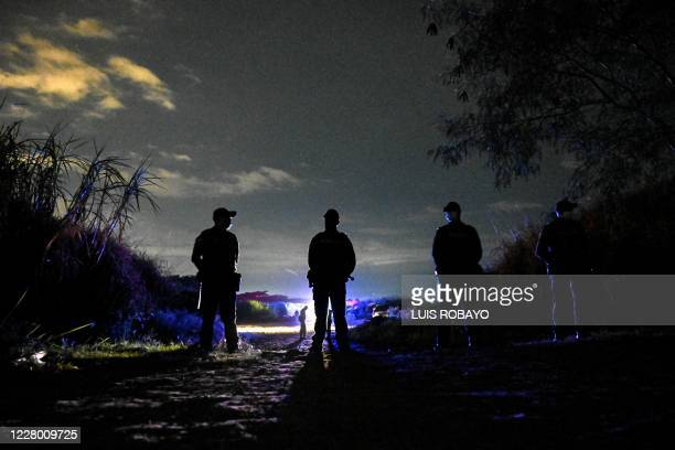 Colombian police officers secure an area where they found the corpses of five young victims in the middle of a sugar cane crop in the Aguablanca...