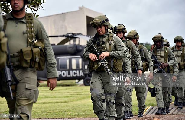 """Colombian police personnel from the """"Jungle"""" special forces unit proceed to embark at their base in San Jose del Guaviare before to take part in an..."""