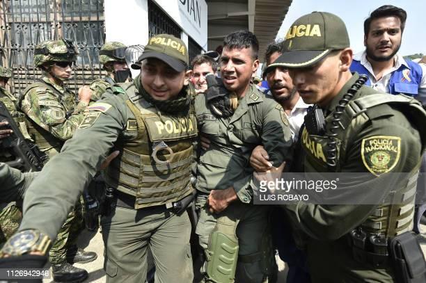 Colombian policemen accompany a Venezuelan police officer who deserted from Venezuela at the Simon Bolivar international bridge in Cucuta Colombia...