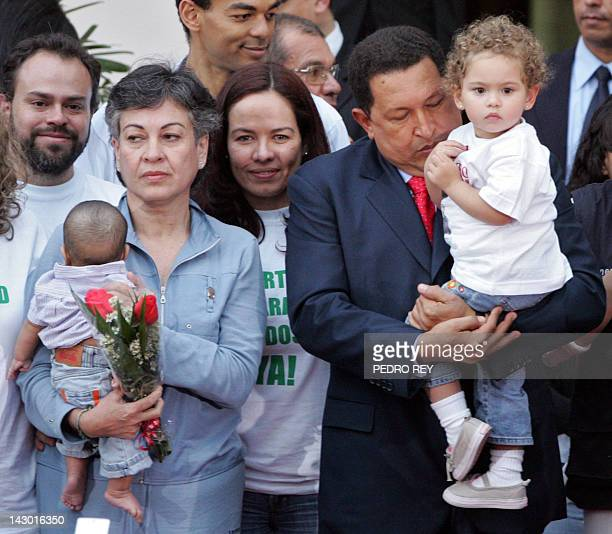 Colombian politician Consuelo Gonzalez de Perdomo is welcomed by Venezuelan president Hugo Chavez at the presidential palace in Caracas on January...