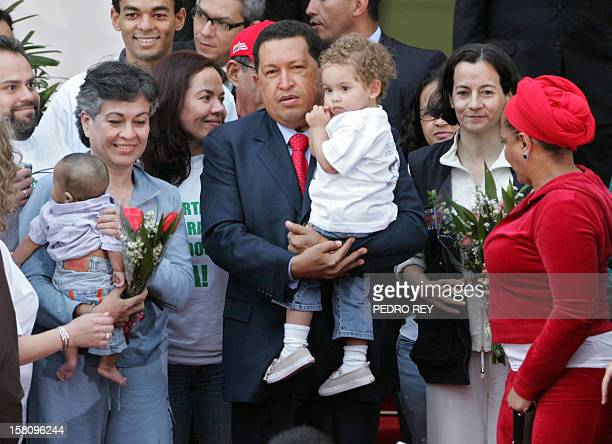 Colombian politicians Clara Rojas and Consuelo Gonzalez de Perdomo are welcomed by Venezuelan president Hugo Chavez at the presidential palace in...
