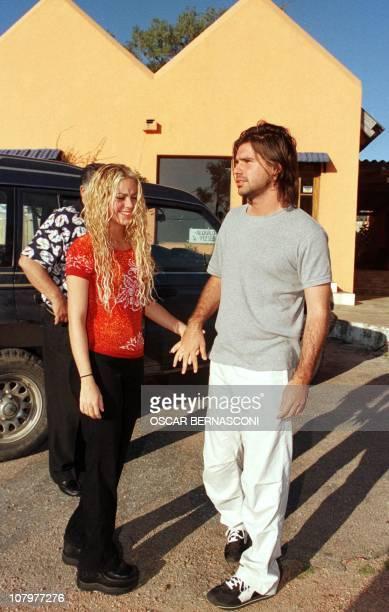 Colombian pop singer Shakira Mebarak joins boyfriend Antonio De La Rua son of Argentine President Fernando De La Rua 28 September 2000 in La Barra...