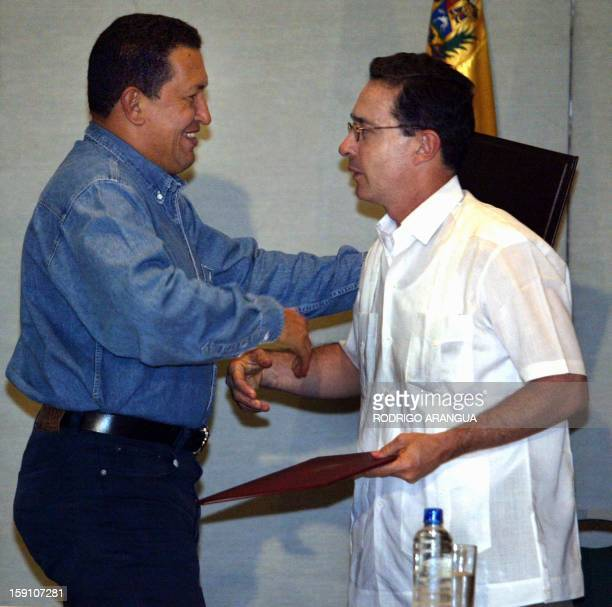 Colombian President Alavaro Uribe greets Venezuela counterpart Hugo Chávez after signing an accord 13 November 2002 in Santa Marta Colombia The two...