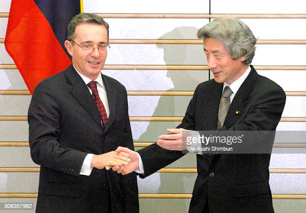 Colombian President Alvaro Uribe and Japanese Prime Minister Junichiro Koizumi shake hands during their meeting at Koizumi's official residence on...