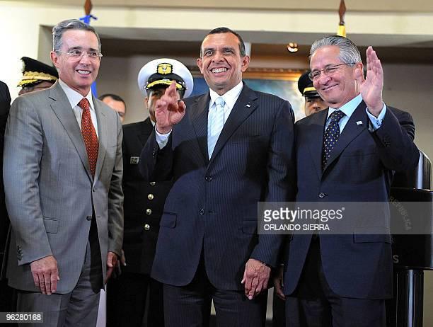 Colombian President Alvaro Uribe his Honduran counterpart Porfirio Lobo and former Honduran President Ricardo Maduro are seen after signing...