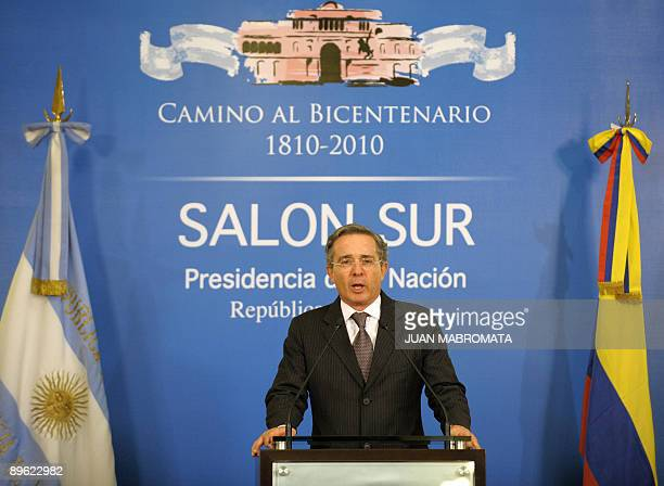 Colombian President Alvaro Uribe speaks during a brief press conference before his meeting with Argentina's President Cristina Fernandez de Kirchner...