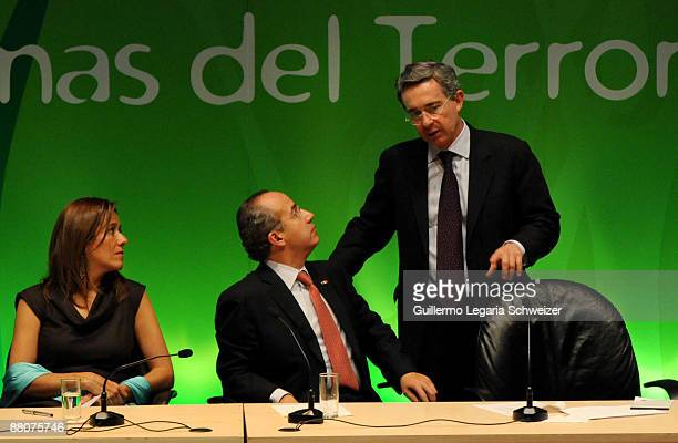 Colombian President Alvaro Uribe talks to Mexican President Felipe Calderon and Mexican First Lady Margarita Zabala during the closure of the 5th...
