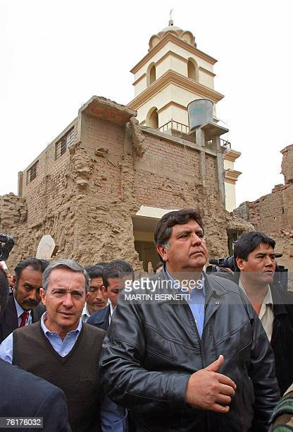 Colombian president Alvaro Uribe visits the collapsed San Clemente church in Pisco with Peruvian president Alan Garcia 19 August 2007 Uribe ordered a...