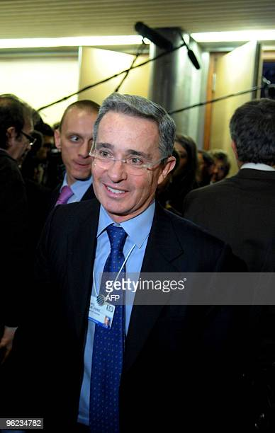 Colombian President Alvaro Velez Uribe talks to a journalist at the congress centre during the World Economic Forum on January 28, 2010 in Davos. The...