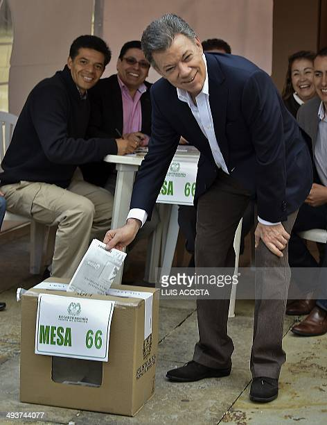 Colombian President and candidate Juan Manuel Santos casts his vote during the presidential election on May 25 in Bogota AFP PHOTO/Luis ACOSTA