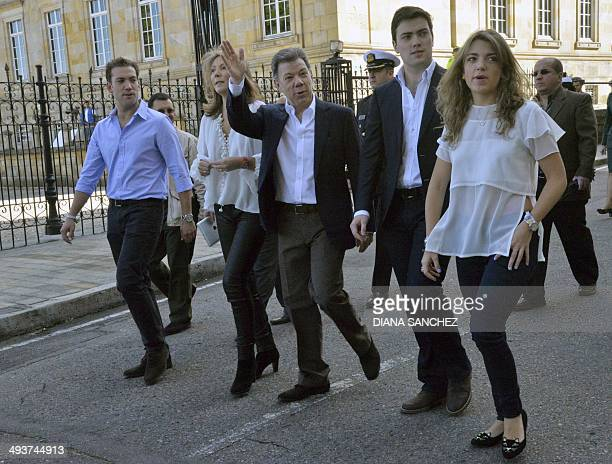 Colombian President and candidate Juan Manuel Santos his wife Maria Clemencia his sons Martin and Esteban and his daughter Maria Antonia walk across...