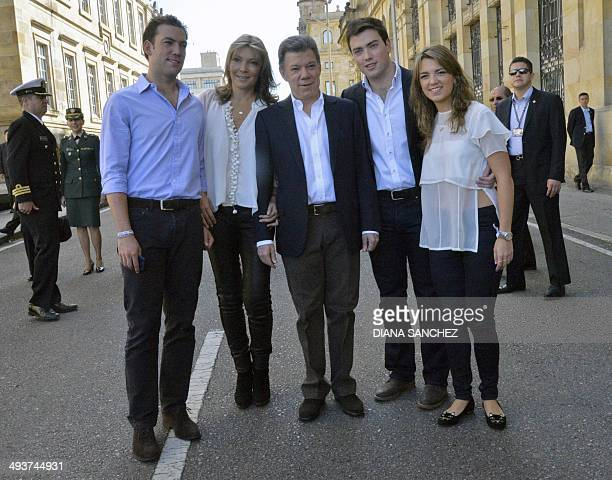 Colombian President and candidate Juan Manuel Santos his wife Maria Clemencia his sons Martin and Esteban and his daughter Maria Antonia pose at...
