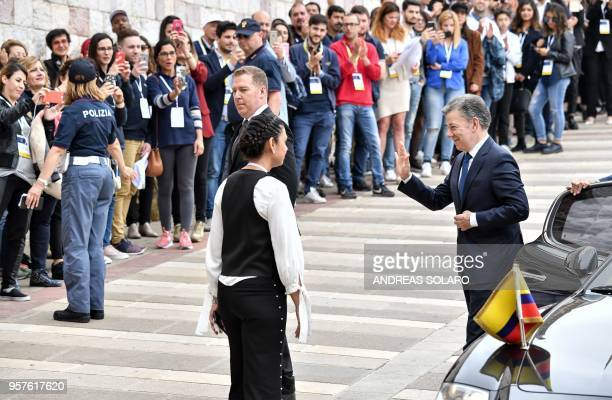 Colombian President and Nobel Peace Prize winner Juan Manuel Santos waves to bystanders as he arrives for the event of the awarding of lamp of St...