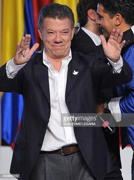 Colombian President and presidential candidate Juan Manuel Santos celebrates after knowing the results of the runoff presidential election on June 15...
