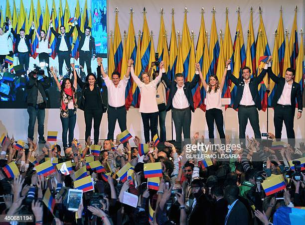 Colombian President and presidential candidate Juan Manuel Santos celebrates with his family and party members after knowing the results of the...