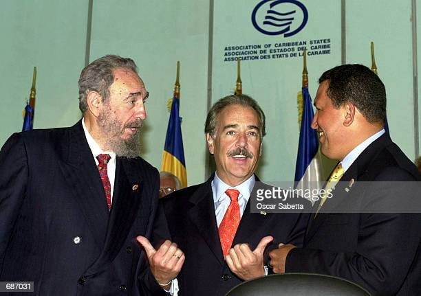 Colombian President Andres Pastrana gestures as he talks with Cuban President Fidel Castro and Venezuelan President Hugo Chavez December 12 2001 at...