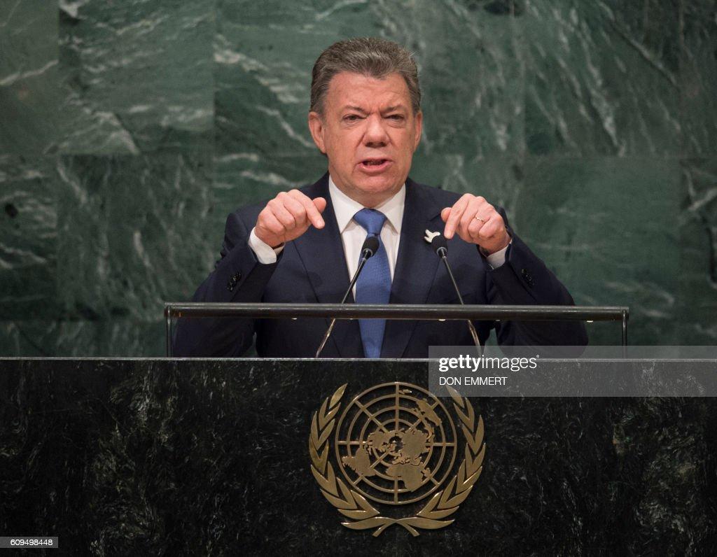 TOPSHOT - Colombian President Juan Manuel Santos addresses the United Nations General Assembly General Debate September 21, 2016 at the United Nations in New York. /