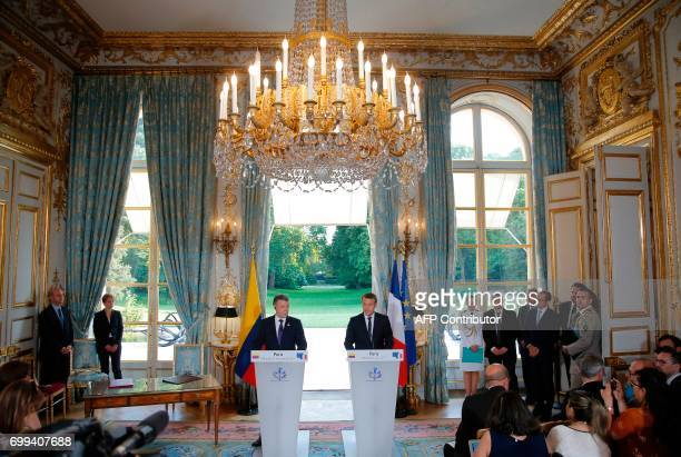 Colombian President Juan Manuel Santos and French President Emmanuel Macron address a joint press conference at the Elysee Palace in Paris France on...