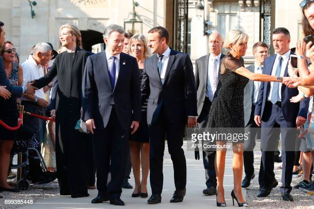 Colombian president Juan Manuel Santos and his wife Maria Clemencia Rodriguez de Santos are welcomed by French president Emmanuel Macron and his wife...