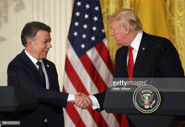Colombian President Juan Manuel Santos and US President Donald Trump shake hands during a joint news conference at the White House May 18 2017 in...