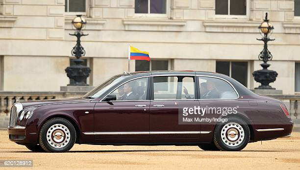 Colombian President Juan Manuel Santos arrives with Prince Charles Prince of Wales in the State Bentley car during his Ceremonial Welcome at Horse...