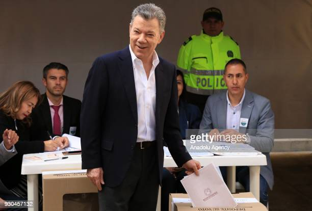 Colombian President Juan Manuel Santos casts his vote during Colombian parliamentary elections at Congress of Colombia in Bogota Colombia on March 11...