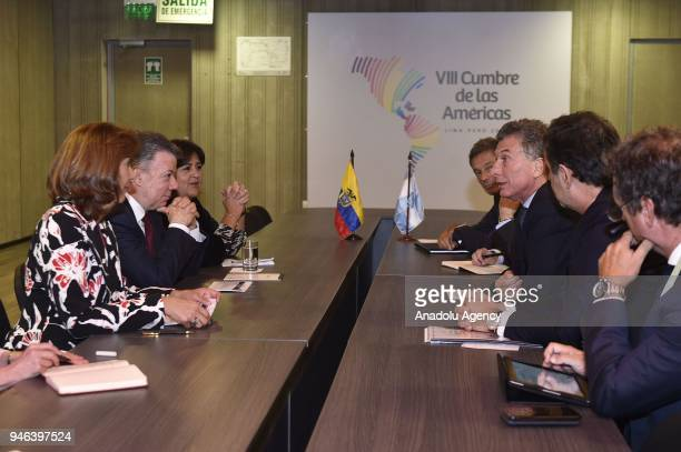 Colombian President Juan Manuel Santos chats with President of Argentina Mauricio Macri during the VIII Summit of the Americas in Lima Peru on April...