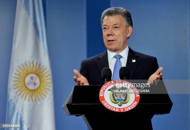 Colombian President Juan Manuel Santos gestures during a joint press conference with Argentina's President Mauricio Macri at Narino presidential...