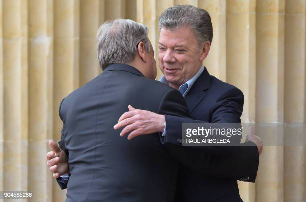 Colombian President Juan Manuel Santos greets United Nations SecretaryGeneral Antonio Guterres at the Narino presidential palace in Bogota Colombia...