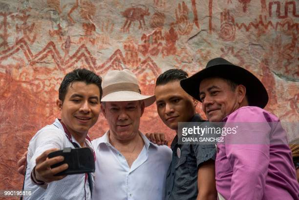 Colombian President Juan Manuel Santos poses for a selfie after announcing the expansion by 15 million hectares of the Chiribiquete National Park...