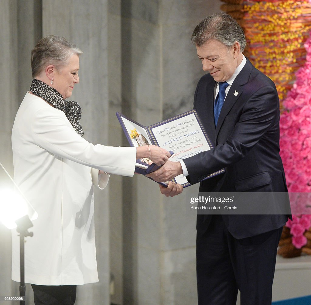 Colombian President, Juan Manuel Santos receives the Nobel Peace Prize from Berit Reiss-Andersen at the Nobel Peace Prize ceremony at Oslo City Town Hall on December 10, 2016 in Oslo, Norway.