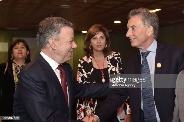 Colombian President Juan Manuel Santos shakes hands with President of Argentina Mauricio Macri during the VIII Summit of the Americas in Lima Peru on...