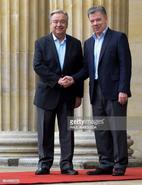 Colombian President Juan Manuel Santos shakes hands with United Nations SecretaryGeneral Antonio Guterres at the Narino presidential palace in Bogota...
